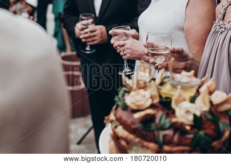 Luxury Life Concept. Champagne And Wine Glasses In Hands At Luxury Wedding Reception At Restaurant.