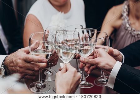 People Toasting With Champagne And Wine Glasses In Hands Clinking At Luxury Wedding Reception At Res