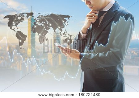 Professional Businessman Analyze Data From His Smart Phone And Cityscape Of Business Centre With Int