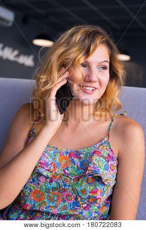 Joyful Young Woman Enjoying Life In A Cafe