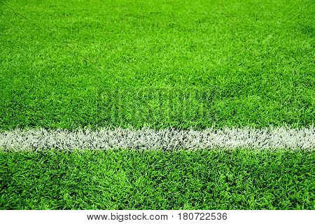 Artificial football or soccer green pitch background