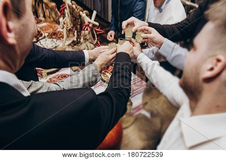 Guest Toasting With Glasses At Luxury Wedding Reception. Man With Groom Performing A Toast With Drin