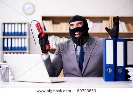 Criminal businessman with dynamite in the office