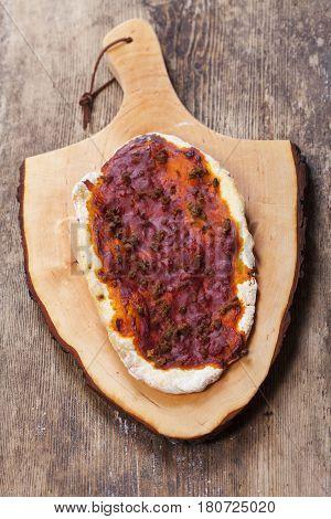 single Lahmacun a turkish pizza on wood