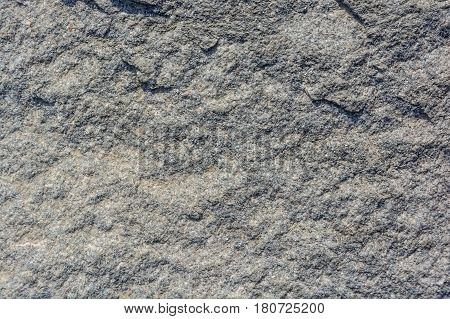 Closeup image of rough uneven grey stone texture background