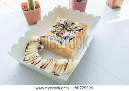 Morning Toast With Banana, Topping By Caramel And Milk.