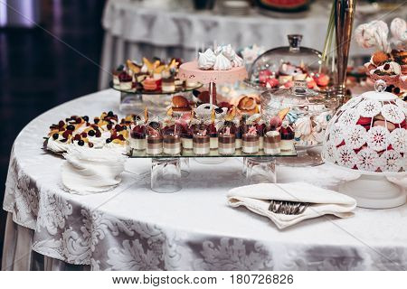 Delicious Candy Bar At Luxury  Wedding Reception. Exclusive Expensive Catering. Table With Modern De