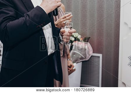 Guest Toasting With Glasses Of Wine At Luxury Wedding Reception. Mother Of Bride And Ceremony Master