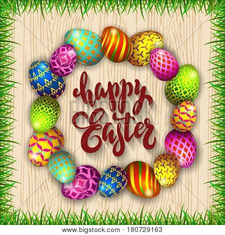 Multi colored easter eggs and grass on a wood background with the hand drawn lettering Happy Easter