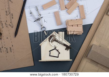 Workplace Of Architect - Little House, Key With Trinket In The Shape Of A House, Wooden Blocks, Cons