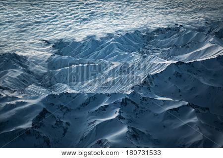 Aerial View From Air Plane Of Snow Mountains
