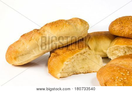 set whole wheat breads, unleavened wheat cake and bun on white background