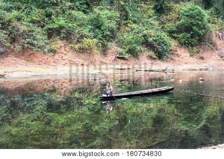 Man Traveling In A Canoe On The River