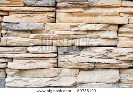 Stone background of decorative wall made of sandstone - texture stone background. Pattern of stone texture background wall. Stone background of light texture stone wall
