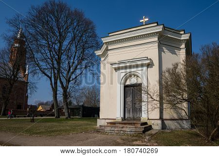 Kernave Lithuania - April 2 2017: A chapel near a church in Kernave Lithuania. The brick chapel from the 19th century houses the mausoleum of the Romer family.