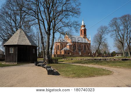Kernave Lithuania - April 2 2017: The old wooden chapel and the new church in Kernave Lithuania. Kernave is historic capital of Lithuania UNESCO World Heritage Site.