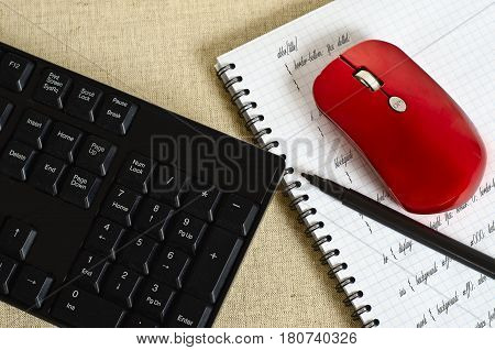 workplace of programmer site. notebook with writing tags and keyboard