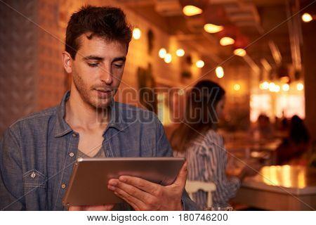 Back To Back Millennials In Restaurant