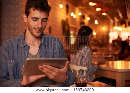 Satisfied Millennial Texting On His Tablet