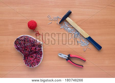 Tools For Handiwork In Stile String Art On Wooden Table