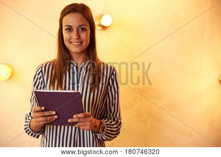 Cutely Smiling Millennial With Her Tablet