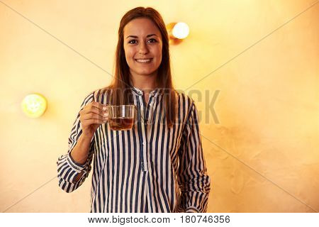 Millennial Looking And Smiling At Camera