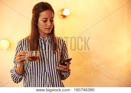 Woman Thoughtfully Reading A Text Message