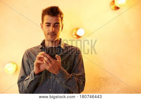 Cute Young Man With His Cellphone