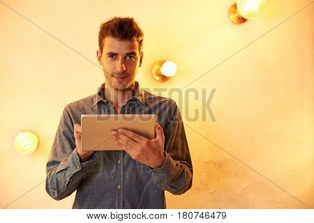 Cute Young Man Posing With Tablet