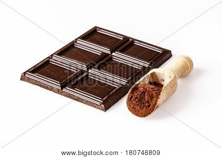 Wooden Spoon With Coacoa Or Cacao And Chocolate On White
