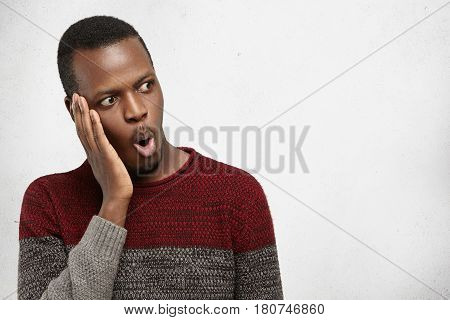 Isolated Portrait Of Shocked Young Afro-american Male In Casual Sweater Looking In Full Disbelief, H