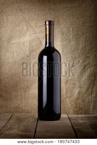 Bottle of red wine on a background of the canvas
