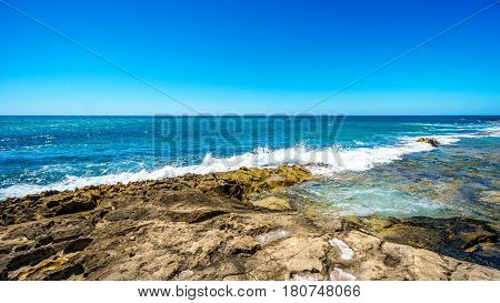 Waves of the Pacific Ocean crashing on the rocks on the shoreline of Ko Olina on the island of Oahu in the island state of Hawaii poster