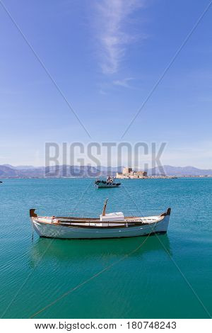 Fishing Boats And Bourtzi Fortress In Nafplion, Greece- Portrait Photo