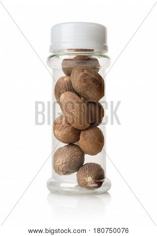 Nutmegs in a glass jar isolated on a white background