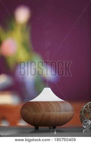Aroma oil diffuser on blurred background