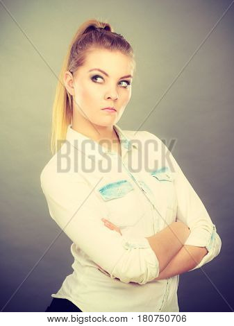 Angry Woman Looking Very Displeased Standing With Arms Folded