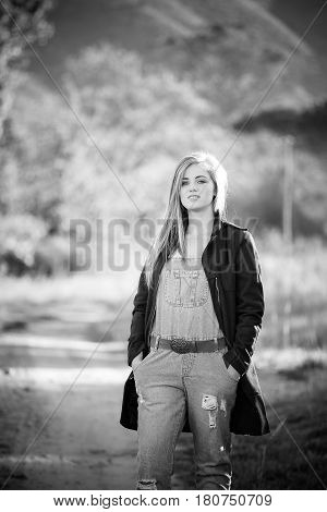 Senior Photo Of A Teen Girl On A Farm Wearing Farm Style Clothing