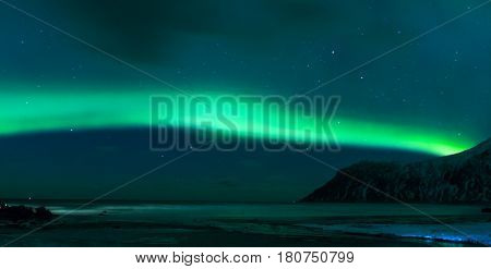 Aurora Borealis Known as Norther Lights Playing with Vivid Colors Over Lofoten Islands in Norway. Horizontal Image Orientation