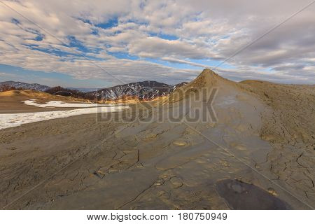 Mud volcanoes with spectaculos clouds Buzau Romania