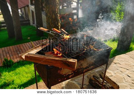BBQ. Flames fire. Wood burning in the brazier. Preparation for cooking barbecue.