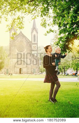 Beautiful and Happy Family of Tourists on the Background of Church of St. Cyril and Methodius in the Karlin Karlinske namesti in Prague Czech Republic. Springtime Summertime or Autumn in Prague.