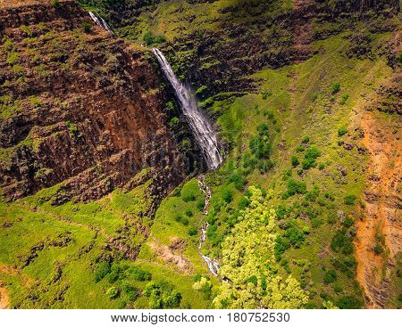 Aerial landscape view of waterfall and green landscape Kauai Hawaii USA