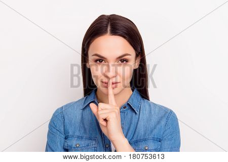 Shhh! Cute Beautiful Girl Touch Lips With  Fingers And Keep Silence