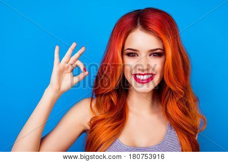 Close-up Portrait Of  Cute Attractive Excited Girl With Long Ginger Fair Hair Showing Okay Sign With