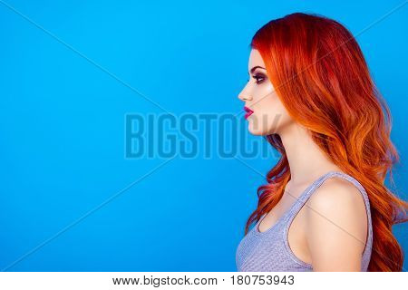 Side View Close Up Photo Of Attractive Pretty Girl With Long Ginger Fair Hair Standing On Blue Backg