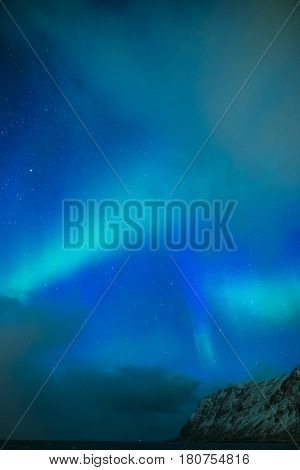 Amazing and Unique Northern Lights Aurora Borealis Over Lofoten Islands in Norway Over the Polar Circle. Vertical Image Composition