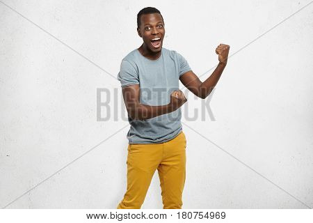 Yes! Handsome Young Afro-american Man Employee Feeling Excited, Gesturing Actively, Keeping Fists Cl