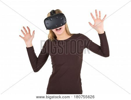 Blonde girl using VR - virtual reality headset isolated on white background