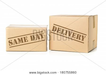 Two corrugated cardboard carton parcels with Same Day Delivery imprint